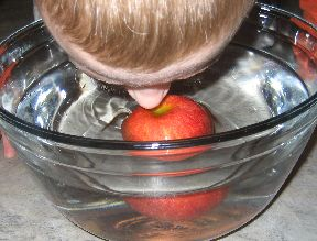 Boy bobbing apples